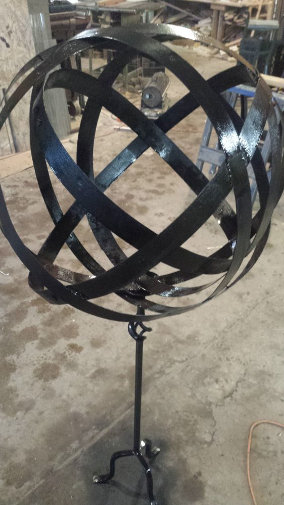 #15 metal sphere on stand $45